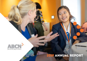 Cover of the 2019 Annual Report, which features, a woman and a female student looking at eachother, smiling.